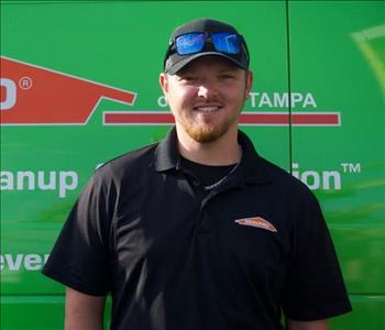 SERVPRO Production Manager Dustin is shown, male employee with hat on