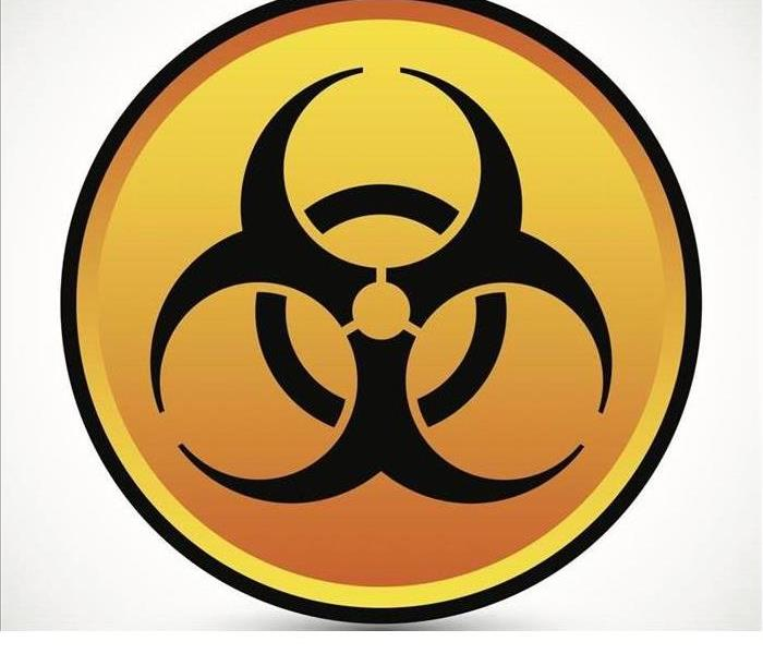 The biohazard symbol is shown, it includes three broken black circles over a sold black circle and an orange background
