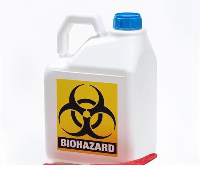 A jug of biohazard cleaning fluid is shown